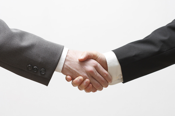 Social Media Marketing: Two Business men shaking hands